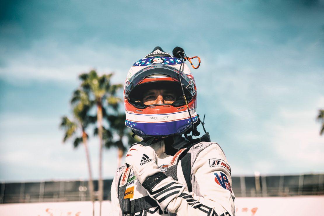 Portrait von Jeroen Bleekemolen mit Helm in der Boxengasse von Long Beach, Los Angeles. Portrait with helmet of Jeroen Bleekemolen in the pitlane of Long Beach, Los Angeles.