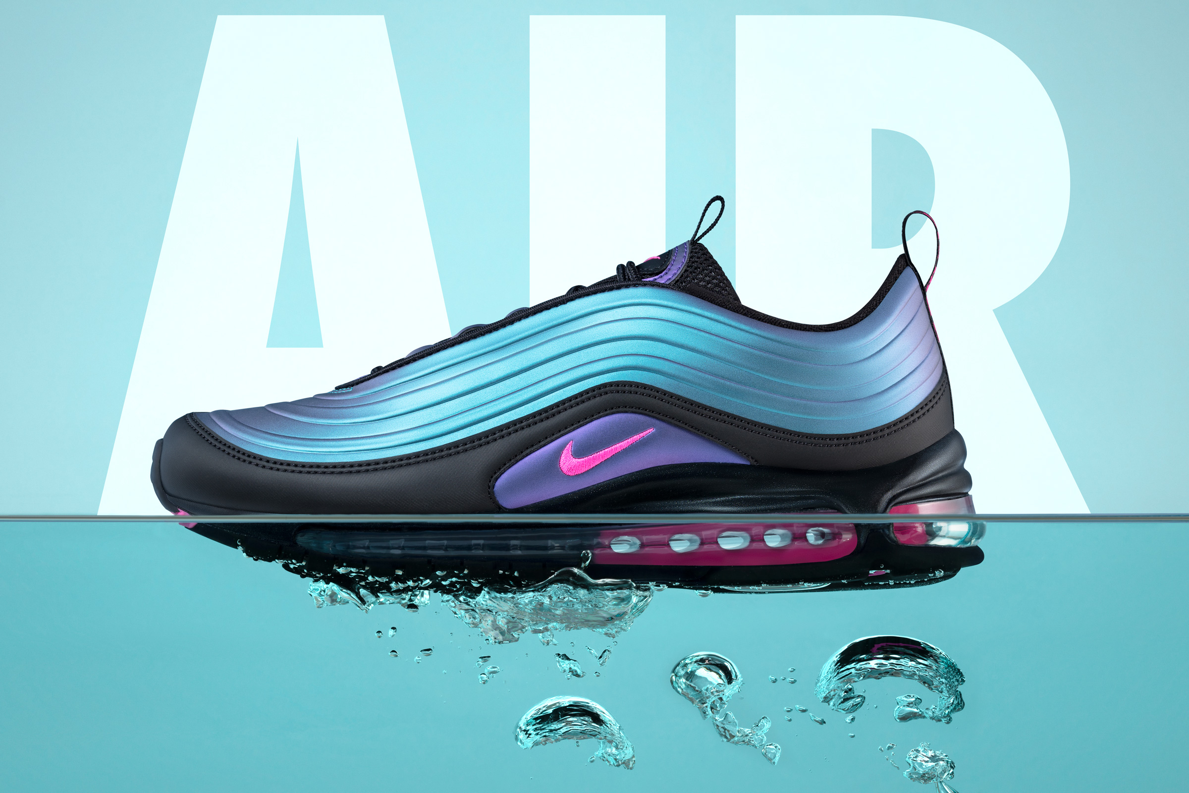 Nike Air Max 97 LX floating in Water above O2-bubbles.